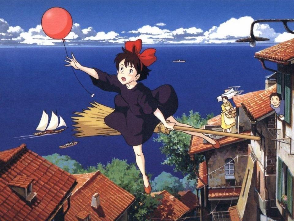 赤い風船とバックの青すぎる海