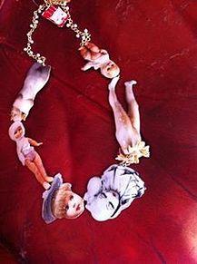 人形ペンダントの画像(プリ画像)